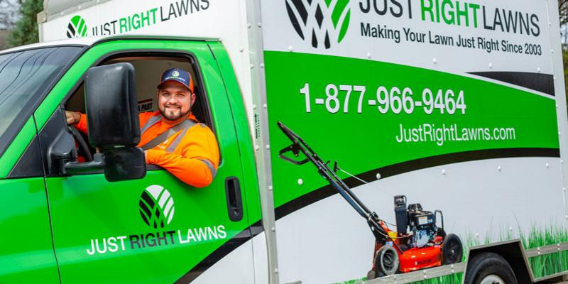 Technician in a white and green Just Right Lawns truck